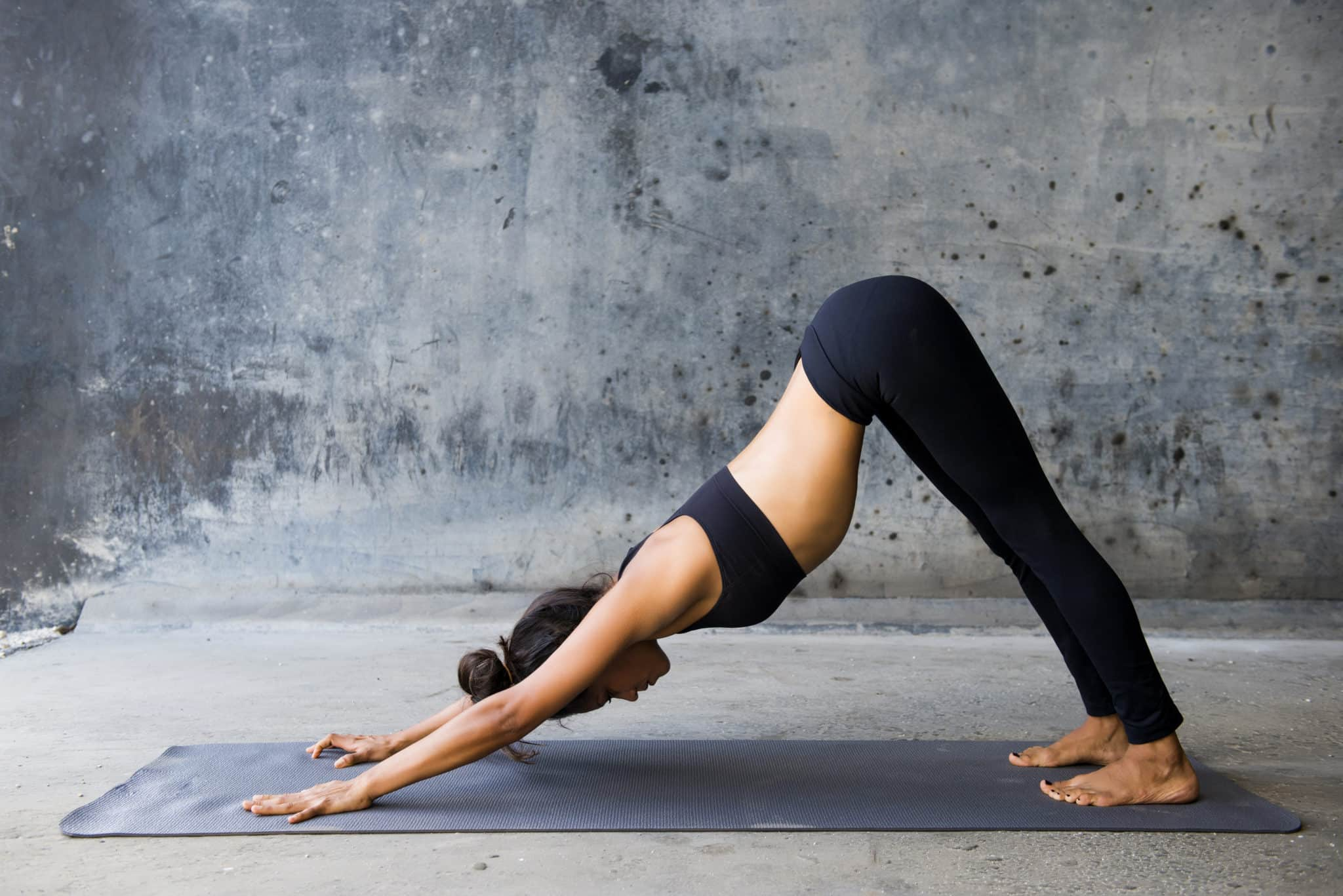 Learn how poses like downward dog can help reduce back pain naturally.