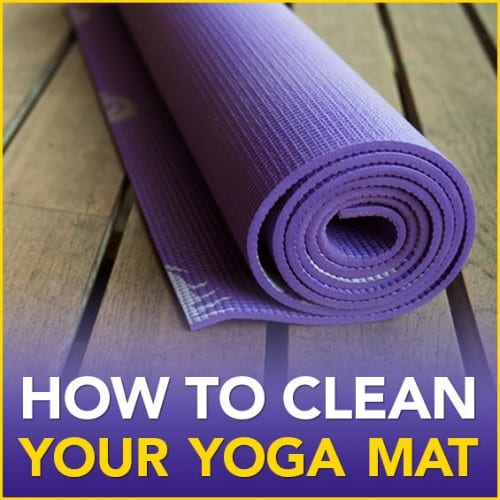 "A purple rolled up yoga mat on a wood floor with the words ""How To Clean Your Yoga Mat"""
