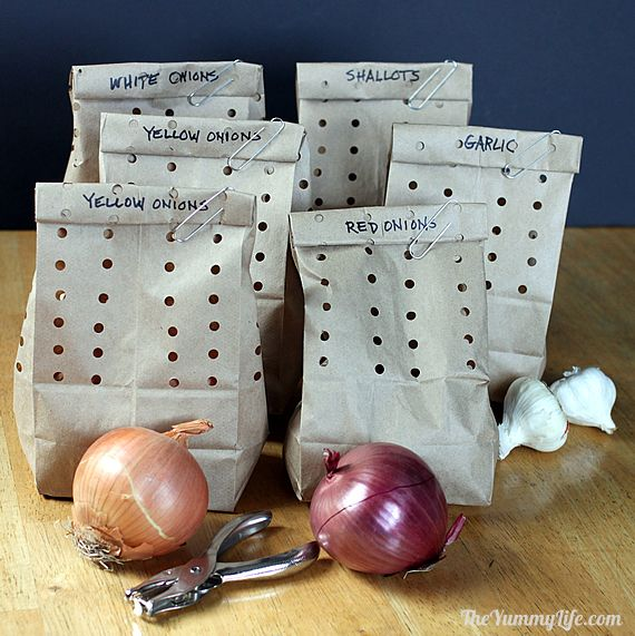 Bags of onions and garlics for a hack to keep them fresh and last longer.