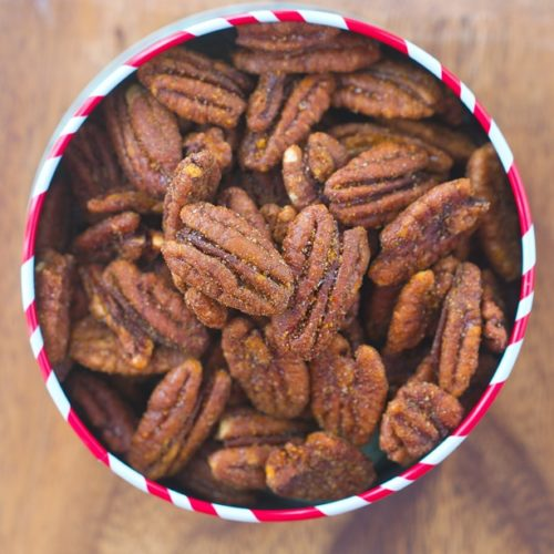 Whip up these easy crock pot roasted cinnamon pecans in just minuted for a healthy snack!