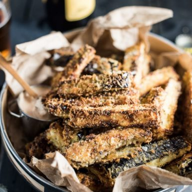 These easy to make Crispy Eggplant Fries are insanely delicious. They are coated in panko and parmesan and oven baked till crisp. They're perfect as a simple, family-friendly side dish recipe or game day appetizer. You'd NEVER guess that they are made with eggplants!